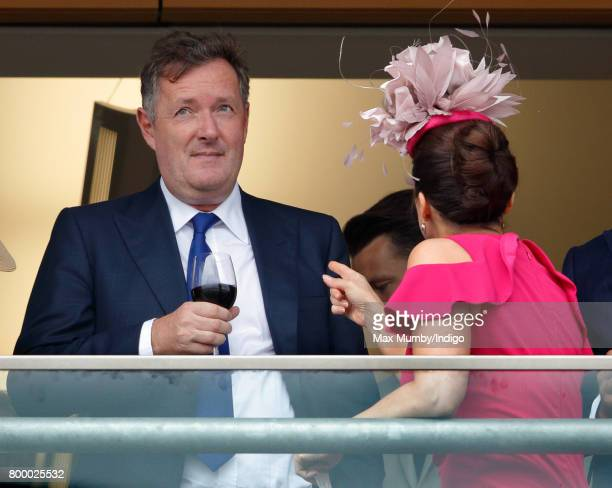 Piers Morgan and Susanna Reid watch the Gold Cup as they attend day 3 Ladies Day of Royal Ascot at Ascot Racecourse on June 22 2017 in Ascot England
