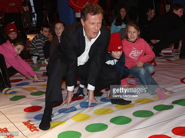 Piers Morgan attends photocall to launch npower's No Power Hour with a giant game of Twister on December 21 2009 in London England