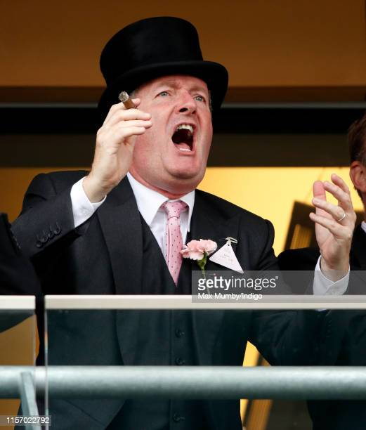 Piers Morgan smokes a cigar whilst watching the racing on day two of Royal Ascot at Ascot Racecourse on June 19, 2019 in Ascot, England.