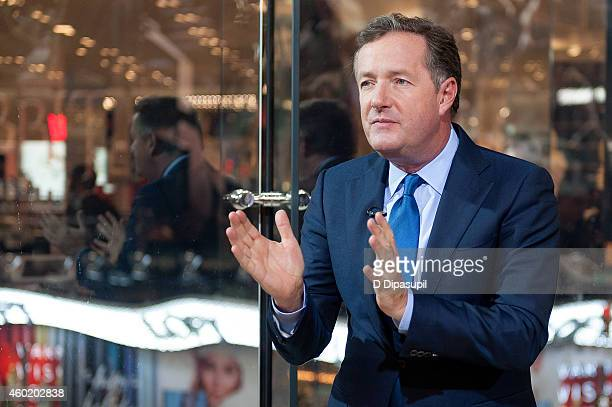 Piers Morgan visits 'Extra' at their New York studios at H&M in Times Square on December 9, 2014 in New York City.