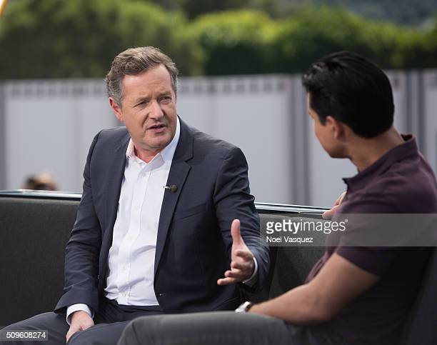 """Piers Morgan visits """"Extra"""" at Universal Studios Hollywood on February 11, 2016 in Universal City, California."""