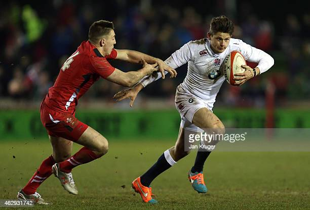 Piers OÕConnor of England holds off Joshua Adams of Wales during the U20 Six Nations match between Wales U20 and England U20 on February 7 2015 in...