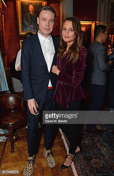 Piers Wenger and Alicia Vikander attend Mr Porter's fifth birthday celebration at The Savile Club on February 20 2016 in London England
