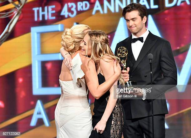 Pierson Fode right and Hunter King center present the Emmy for Outstanding Supporting Actress to Jessica Collins left at the 43rd Annual Daytime Emmy...