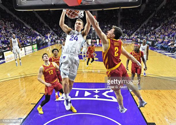 Pierson McAtee of the Kansas State Wildcats dunks the ball against Caleb Grill of the Iowa State Cyclones during the first half at Bramlage Coliseum...
