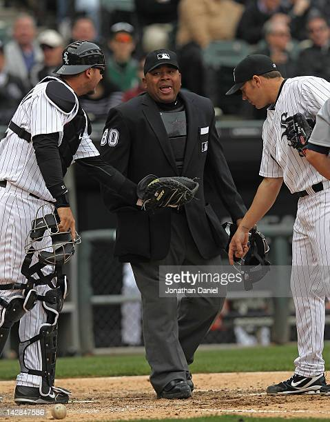 J Pierzynski and Jake Peavy of the Chicago White Sox argue a call with home plate umpire Adrian Johnson during the opening day game against the...