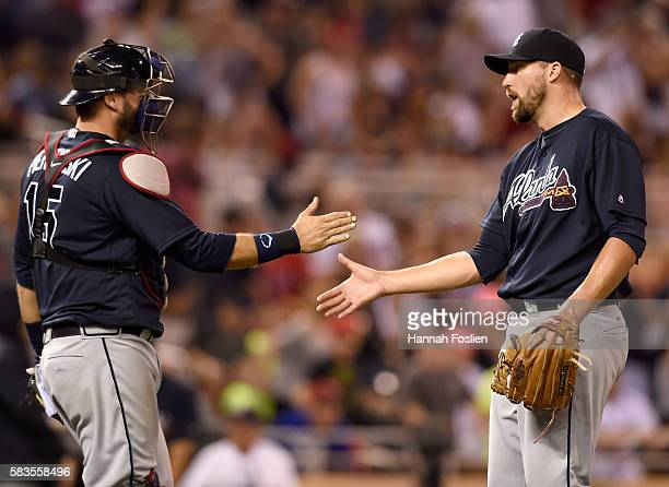 J Pierzynski and Jim Johnson of the Atlanta Braves celebrate a wining the game against the Minnesota Twins on July 26 2016 at Target Field in...
