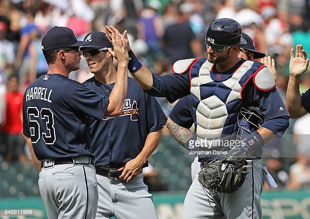 J Pierzynski and Lucas Harrell of the Atlanta Braves celebrate a win against the Chicago White Sox at US Cellular Field on July 10 2016 in Chicago...