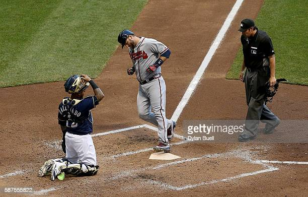 J Pierzynski of the Atlanta Braves crosses home plate after hitting a home run in the fifth inning against the Milwaukee Brewers at Miller Park on...