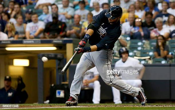 J Pierzynski of the Atlanta Braves hits a double in the third inning against the Milwaukee Brewers at Miller Park on August 10 2016 in Milwaukee...