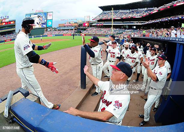 A J Pierzynski of the Atlanta Braves is congratulated by teammates after hitting a tworun home run in the second inning against the Colorado Rockies...