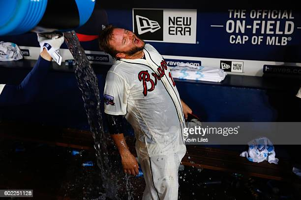 J Pierzynski of the Atlanta Braves is soaked with water from the cooler following their 43 in extra innings against the New York Mets at Turner Field...