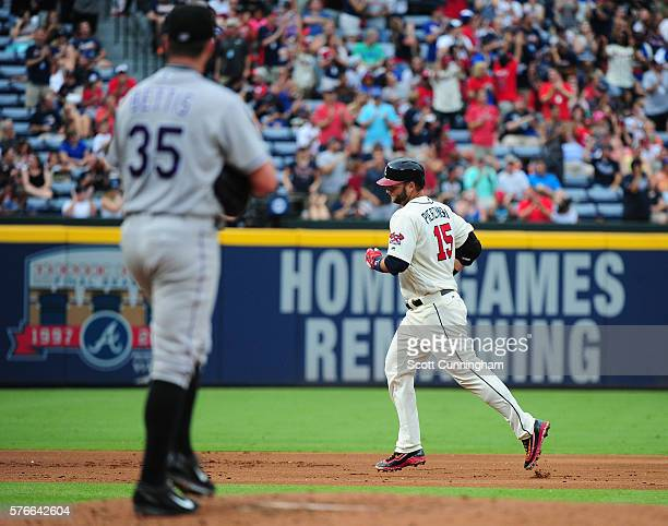 A J Pierzynski of the Atlanta Braves rounds the bases after hitting a tworun home run in the second inning against Chad Bettis of the Colorado...