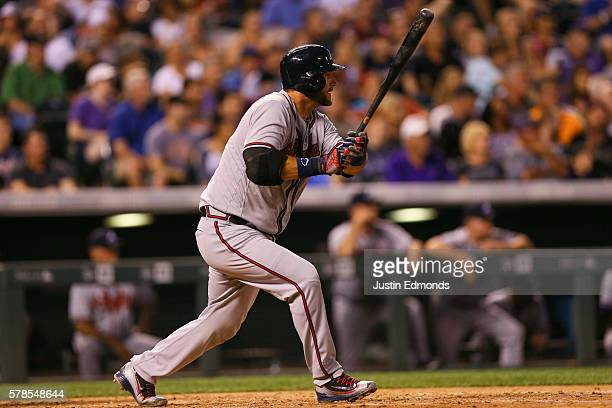 J Pierzynski of the Atlanta Braves watches his RBI double during the seventh inning against the Colorado Rockies at Coors Field on July 21 2016 in...