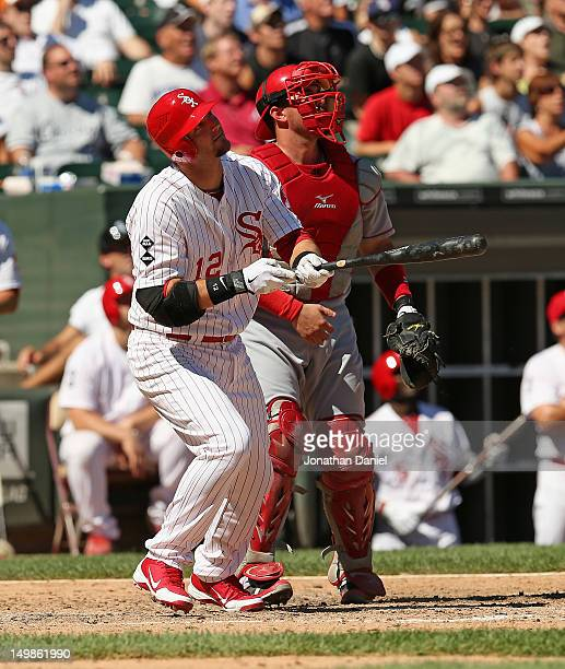 J Pierzynski of the Chicago White Sox and Bobby Wilson of the Los Angeles Angels of Anaheim watch the flight of Pierzynski's tworun home run in the...