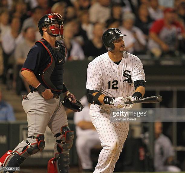 J Pierzynski of the Chicago White Sox and Jarrod Saltalamacchia of the Boston Red Sox follow the flight of Pierzynski's tworun home run in the 7th...