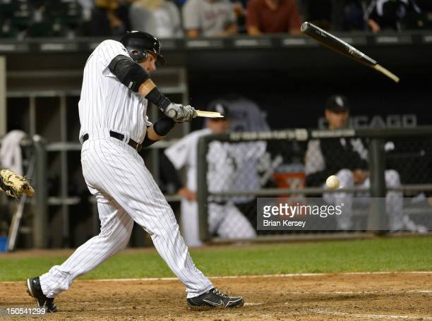 J Pierzynski of the Chicago White Sox breaks his bat as he hits an infield single during the seventh inning against the New York Yankees at US...