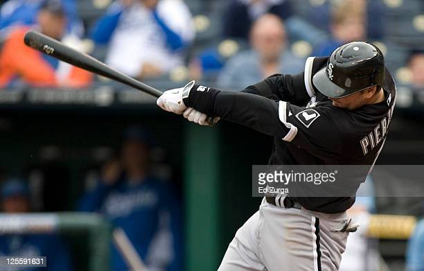 J Pierzynski of the Chicago White Sox hits a threerun home run in the eighth inning during a game against the Kansas City Royals at Kauffman Stadium...