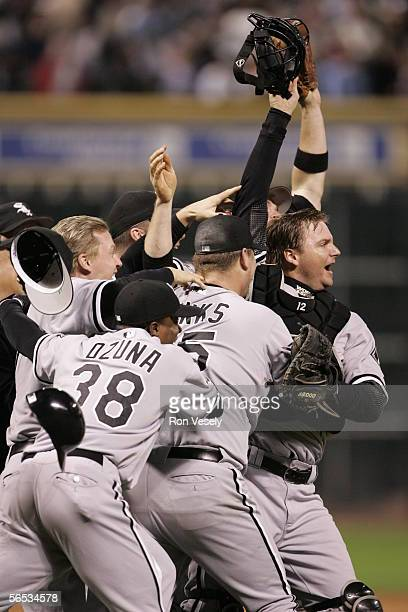 Pierzynski of the Chicago White Sox leads the way as the White Sox celebrate winning Game 4 of the 2005 World Series against the Houston Astros at...