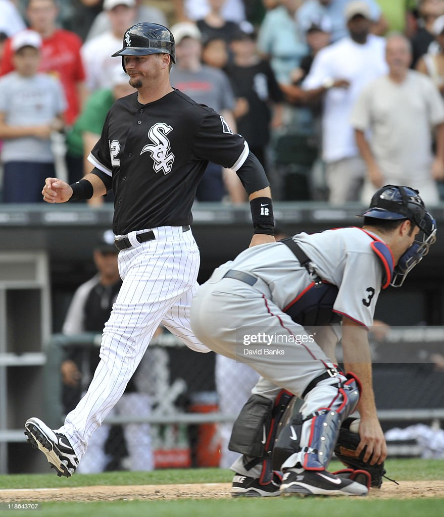 A.J. Pierzynski # 12 of the Chicago White Sox scores the winning run against the Minnesota Twins on July 9, 2011 at U.S. Cellular Field in Chicago, Illinois. The White Sox defeated the Twins 4-3.