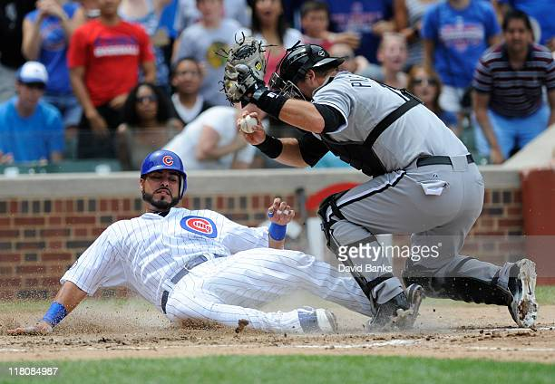 J Pierzynski of the Chicago White Sox tags Geovany Soto of the Chicago Cubs out at home in the third inning on July 3 2011 at Wrigley Field in...