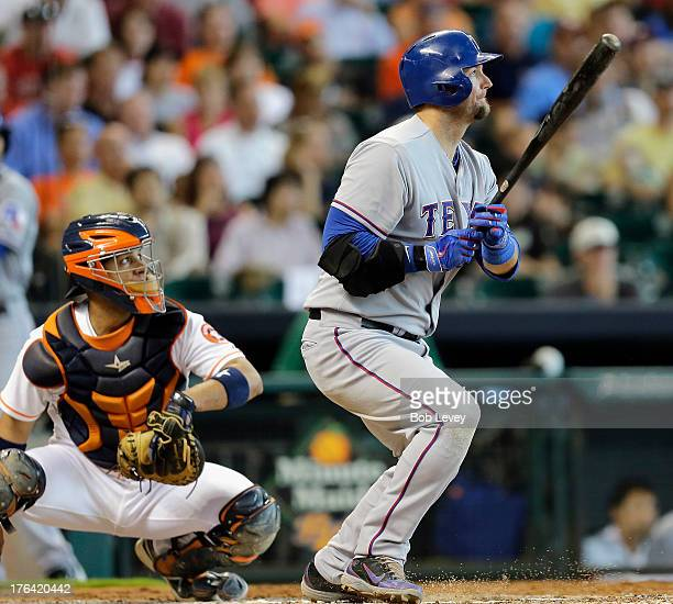 J Pierzynski of the Texas Rangers singles in the fourth inning as catcher Carlos Corporan of the Houston Astros watches the ball at Minute Maid Park...