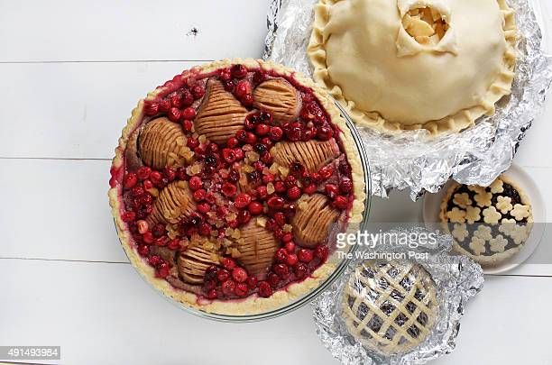 WASHINGTON DC Pies cooked and uncooked clockwise from top Zesty Apple Pie Boozy DriedFruit Pie Pecangipane Pear and Cranberry Tart photographed in...