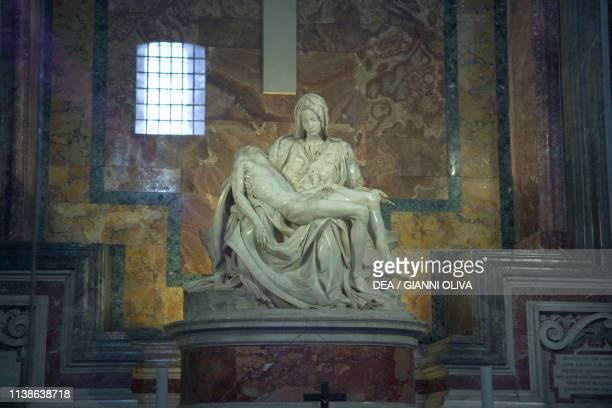 Pieta marble sculpture by Michelangelo Buonarroti, St Peter's Basilica, Rome, Rome , Vatican City State, 15th century.