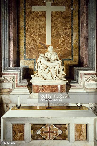 Pieta' marble sculpture by Michelangelo located in the first chapel on the right St Peter's Basilica Rome Vatican City 15th century