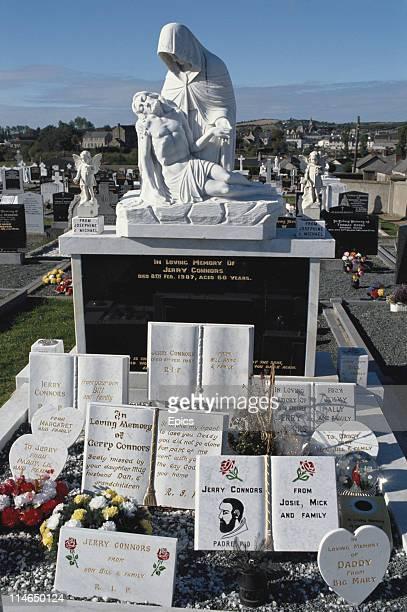 A pieta marks a tombstone in St Michaels cemetery Gorey County Wexford Ireland circa 1992 The cemetery is the resting place of many tinkers and...