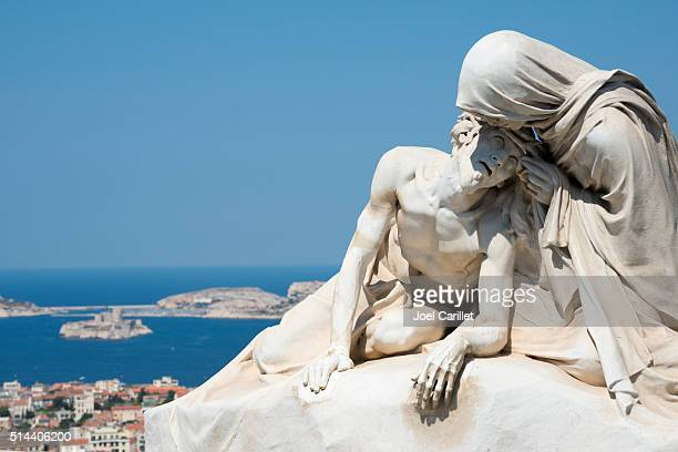 Pieta sculpture and Château d'If in Marseille, France