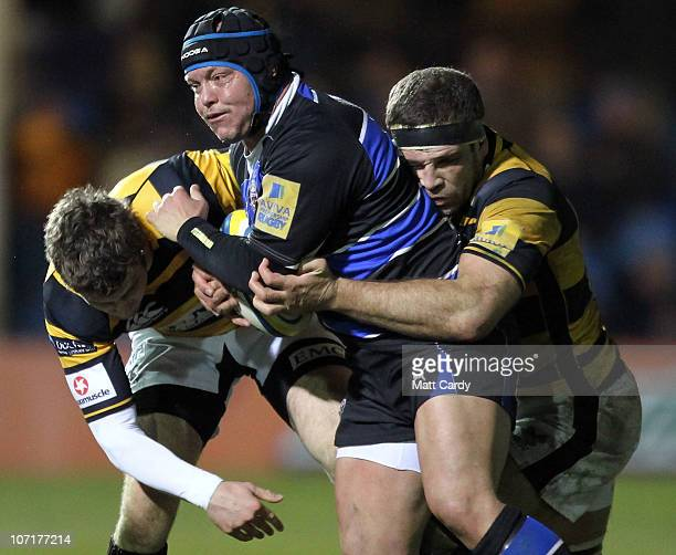 Pieter Dixon of Bath is tackled during the Aviva Premiership game between Bath and London Wasps at the Recreation Ground on November 27 2010 in Bath...