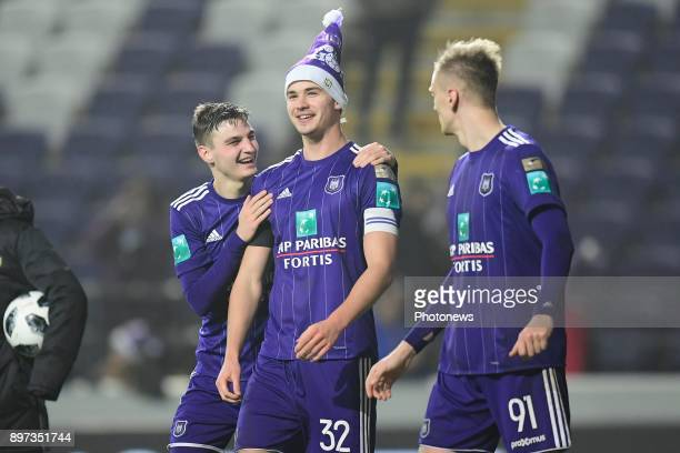 Pieter Gerkens midfielder of RSC Anderlecht Leander Dendoncker midfielder of RSC Anderlecht and Lukasz Teodorczyk forward of RSC Anderlecht greeting...