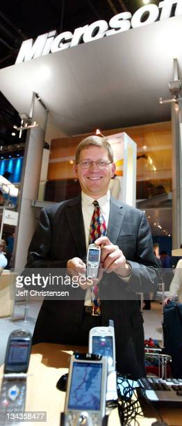 Pieter Knook Senior Vice President of Mobile and Embedded Devices at Microsoft shows a new phone by Orange in the Microsoft booth at the...