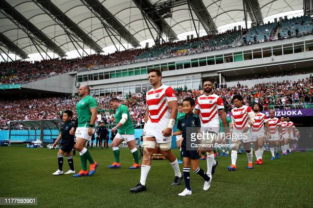 Pieter Labuschagne of Japan and Rory Best of Ireland lead the team entering the pitch prior to the Rugby World Cup 2019 Group A game between Japan...