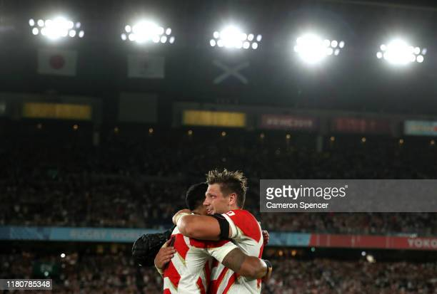 Pieter Labuschagne of Japan celebrates victory with Timothy Lafaele after the Rugby World Cup 2019 Group A game between Japan and Scotland at...