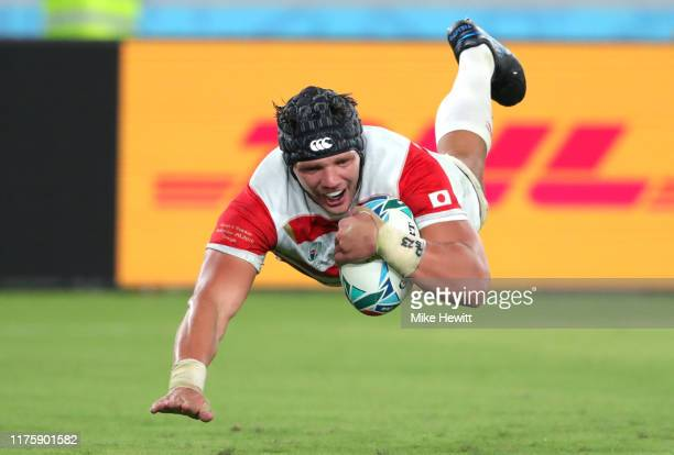 Pieter Labuschagne of Japan scores his team's third try during the Rugby World Cup 2019 Group A game between Japan and Russia at the Tokyo Stadium on...