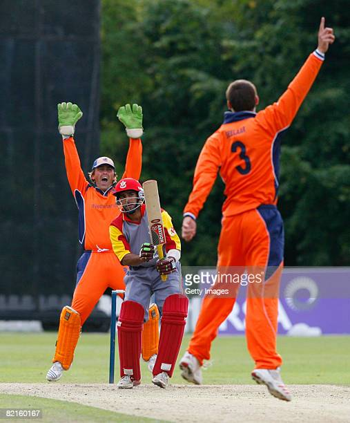 Pieter Seelaar of the Netherlands and teammate J. Smits celebrate as Steven Welsh of Canada is caught out during the Canada v Netherlands ICC World...