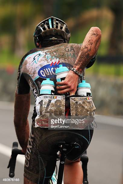 Pieter Serry of Belgium and Omega PharmaQuickstep collects bidons from the team carduring the eleventh stage of the 2014 Giro d'Italia a 249km medium...