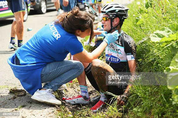 Pieter Serry of Belgium and Omega PharmaQuickstep receives medical attention at the roadside after a crash during the eleventh stage of the 2014 Giro...