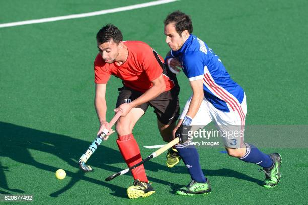 Pieter van Straaten of France tackles Ashraf Said of Egypt during day 8 of the FIH Hockey World League Men's Semi Finals 7th8th place match between...