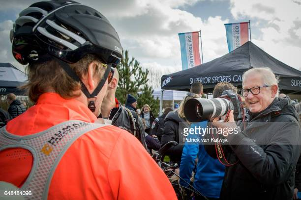 Pieter van Vollenhoven takes an picture of his son Prince Pieter-Christiaan at the Hollandse 100 ice skating and cycling fund raising event at...