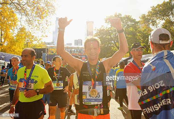PieterChristiaan van OranjeNassau the Crown Prince of The Netherlands celebrates after crossing the finish line during the 2016 TCS New York City...