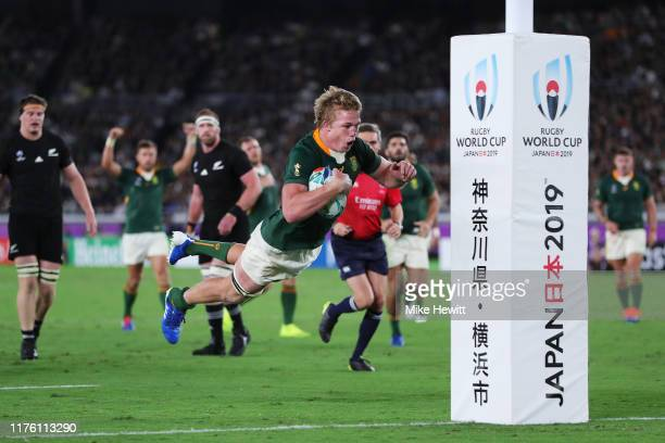 Pieter-Steph du Toit of South Africa dives to scores his side's first try during the Rugby World Cup 2019 Group B game between New Zealand and South...