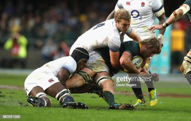 PieterSteph du Toit of South Africa is tackled by Joe Launchbury and Maro Itoje during the third test match between South Africa and England at...