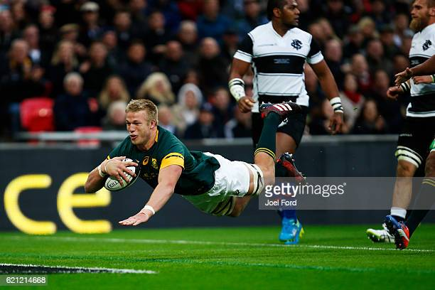LONDON ENGLAND NOVEMBER PieterSteph Du Toit of South Africa scores a try during the Killik Cup match between Barbarians and South Africa at Wembley...