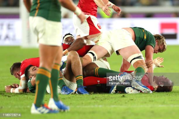 Pieter-Steph du Toit of South Africa tackles Alun Wyn Jones of Wales during the Rugby World Cup 2019 Semi-Final match between Wales and South Africa...
