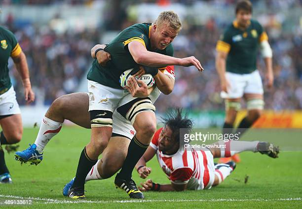 Pieter-Steph Du Toit of South Africa tries to break through the defence during the 2015 Rugby World Cup Pool B match between South Africa and Japan...