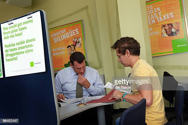 S Pieto Tondini HR Block Tax Associate works on Diego Sanclemente's tax form the day before the Internal Revenue Service deadline on April 14 2010 in...