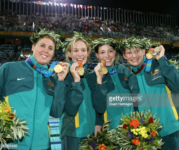 Pietra Thomas, Jodie Henry, Giaan Rooney and Leisel Jones of Australia win the gold medal for the women's swimming 4 x 100 metre medley relay event...